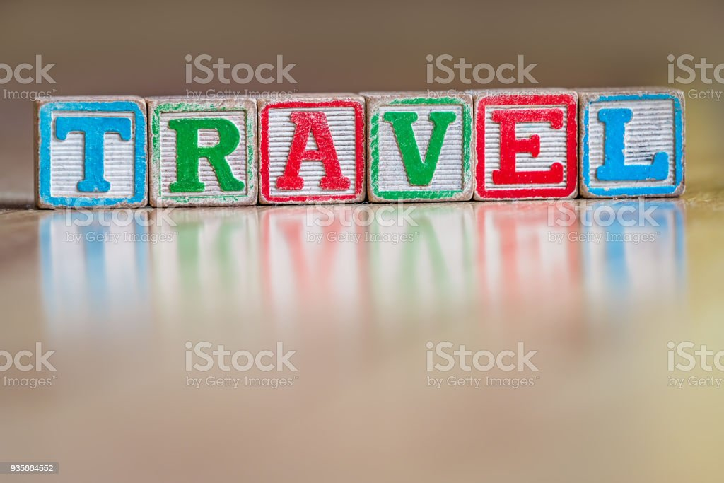 Toy letter blocks spelling the word travel stock photo