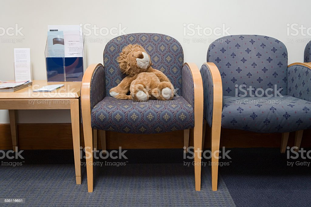 Toy lion in hospital waiting room stock photo