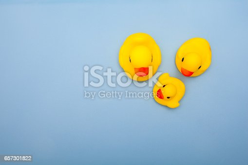 istock toy of yellow duck family on blue backgrounds 657301822