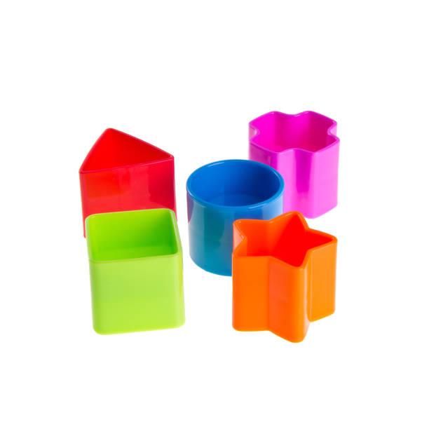 배경에 장난감 또는 아기 장난감 플라스틱 모양 선별기 스톡 사진