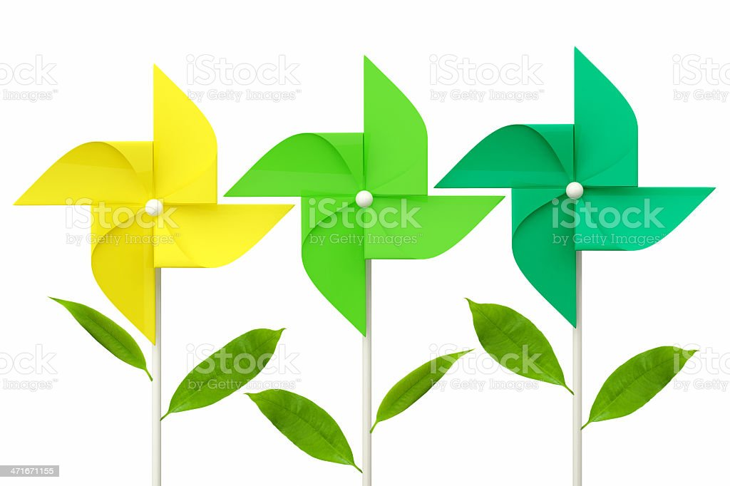 toy pinwheel with green leafs on white background royalty-free stock photo