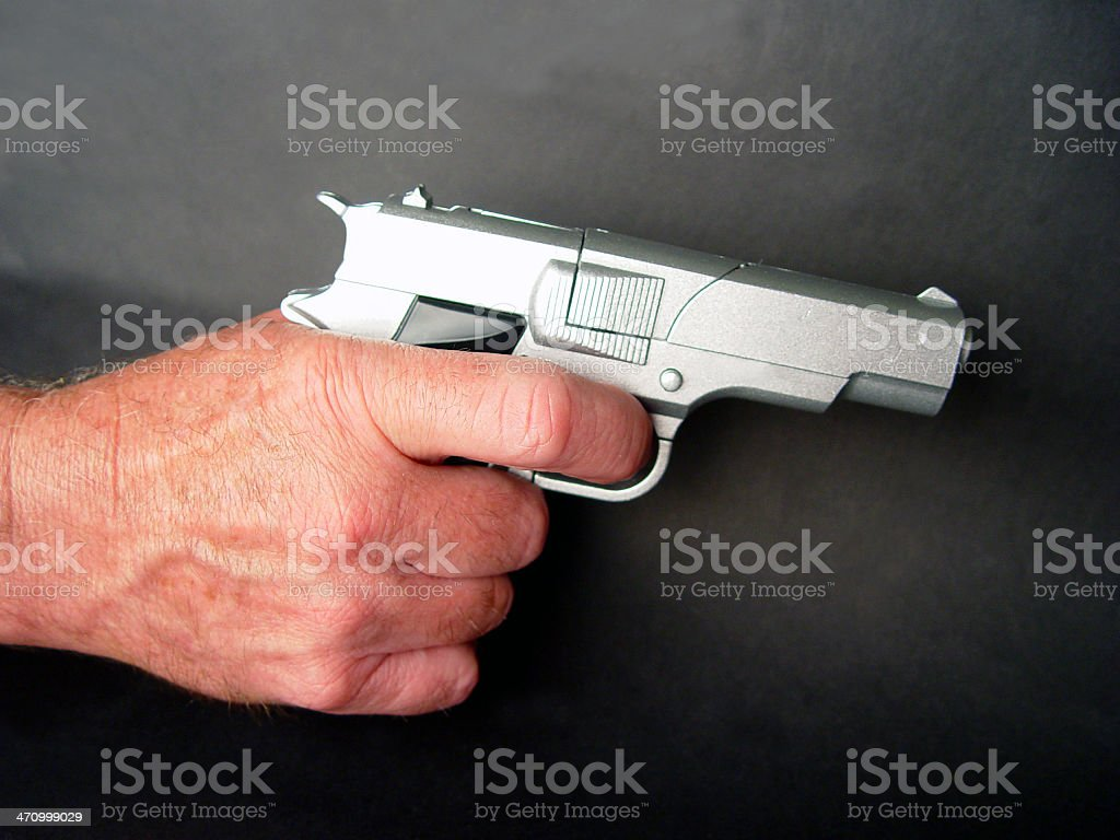 Toy pistol in hand royalty-free stock photo