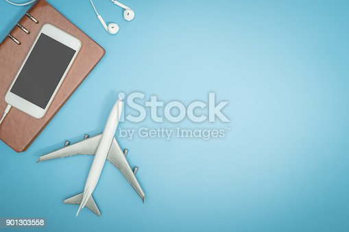 istock Toy plane and mobile phone on blue copy space for travel concept poster and banner 901303558