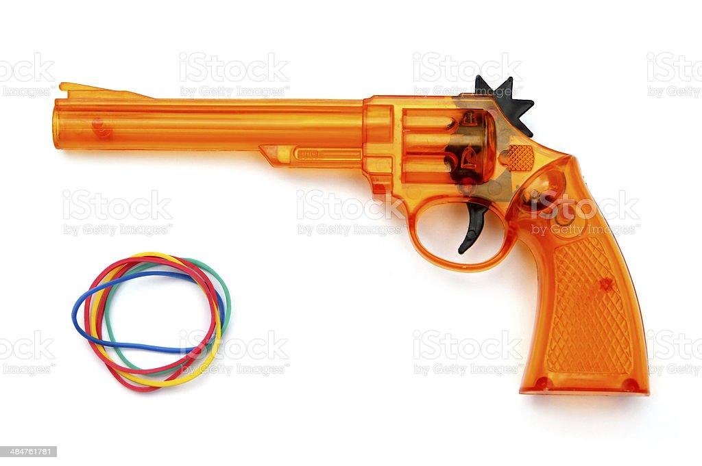 Toy plastic gun , on a white background stock photo