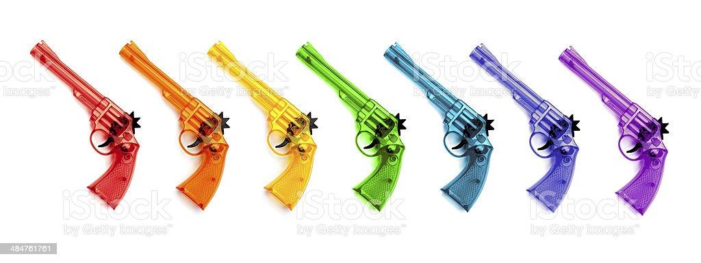 Toy plastic guns , on a white background stock photo