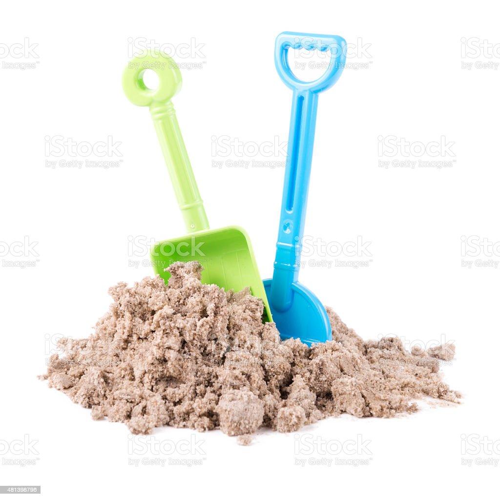 Toy rake and spade isolated on white background stock photo