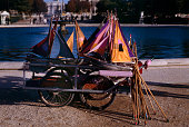 toy sailboats, with pushing poles, for rent in the Tuileries Garden, Paris, France