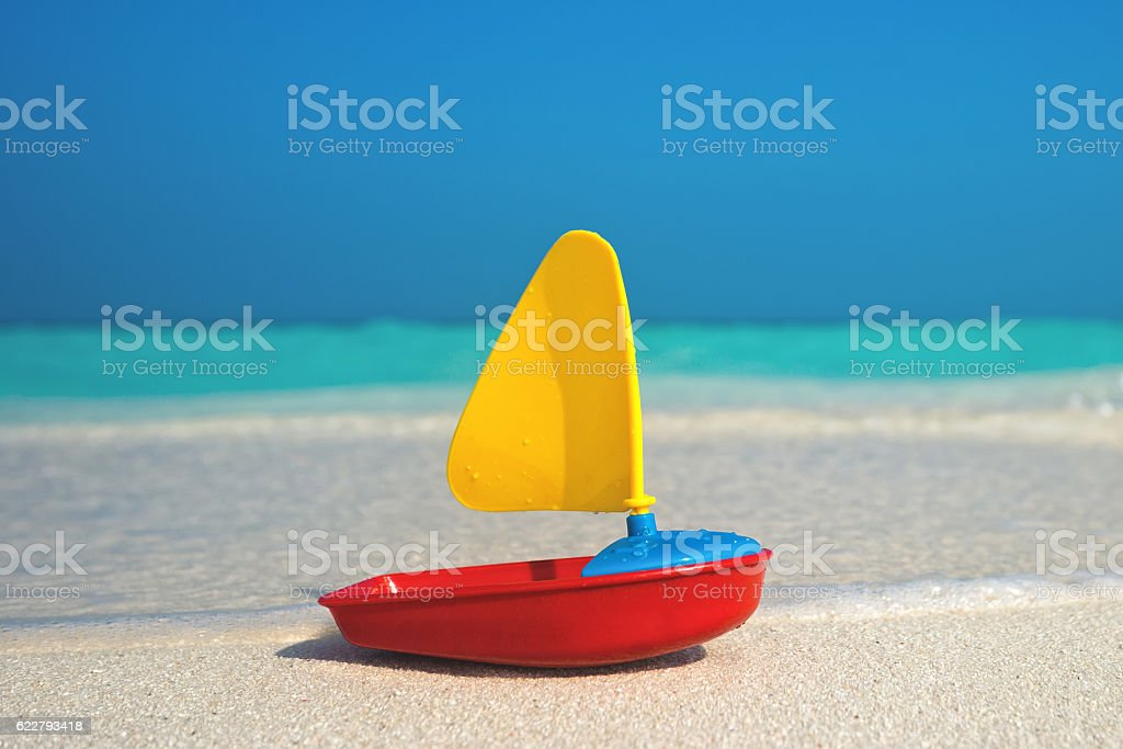 toy ship on the sea background stock photo