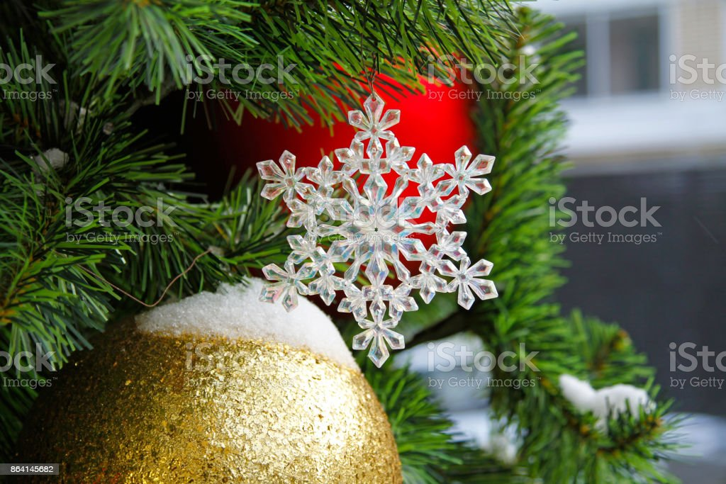 Toy snowflake hanging on the branch of tree royalty-free stock photo