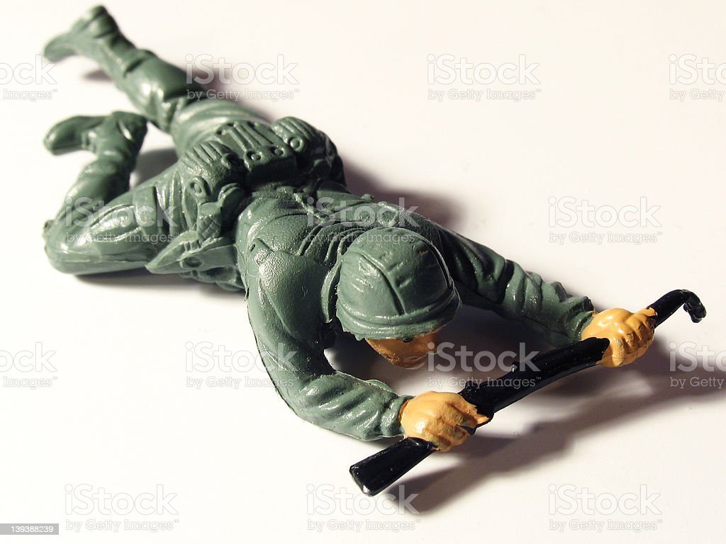 Toy Soldier crawling stock photo