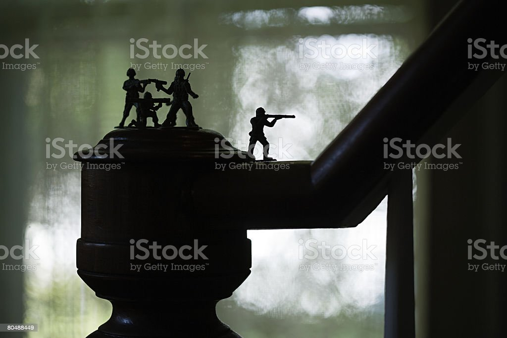 Toy soldiers on banister 免版稅 stock photo