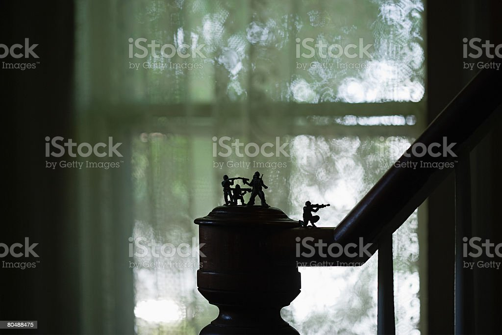 Toy soldiers on banister royalty-free 스톡 사진