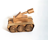 toy tank made by children from corrugated cardboard are fighting. toy cardboard tank isolated on a white background. February 23. Men's day.