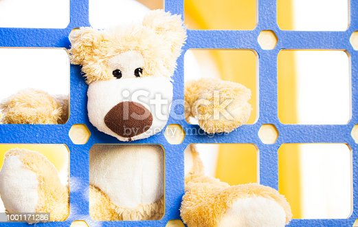istock toy teddy bear in the park 1001171286