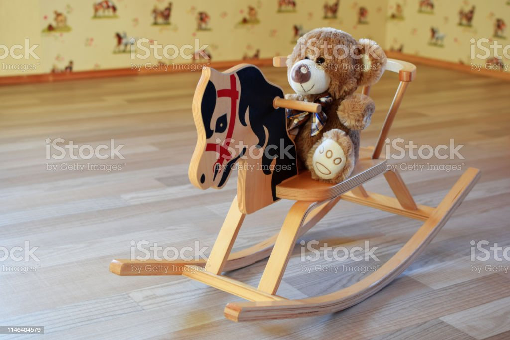 Toy Teddy Bear Sitting On Wooden Rocking Horse Stock Photo Download Image Now Istock