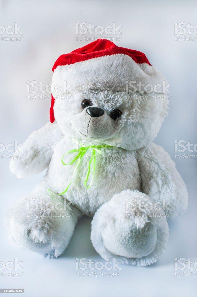 e1c0fd9cde7b6 Toy Teddy Bear Wearing Santa Hat On A Light Background Stock Photo ...