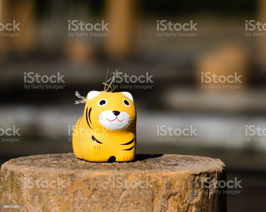 A toy tiger that is actually a Shinto fertility charm. stock photo