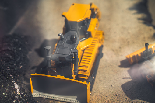 toy tractor in the scenery of coal mining
