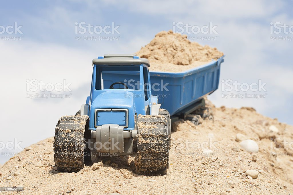 Toy tractor with sand load stock photo