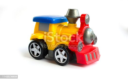 912120622 istock photo toy train. children's toy. plastic yellow with red the train with a blue roof 1143526858