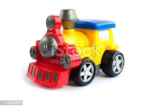 912120622 istock photo toy train. children's toy. plastic yellow with red the train with a blue roof 1143526894