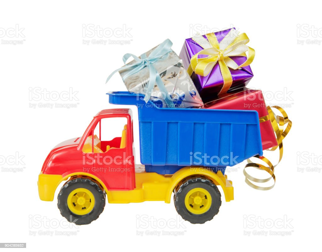 Toy truck carries gift boxes stock photo