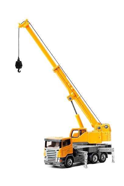 toy truck crane yellow toy truck crane isolated over white backgroung mobile crane stock pictures, royalty-free photos & images