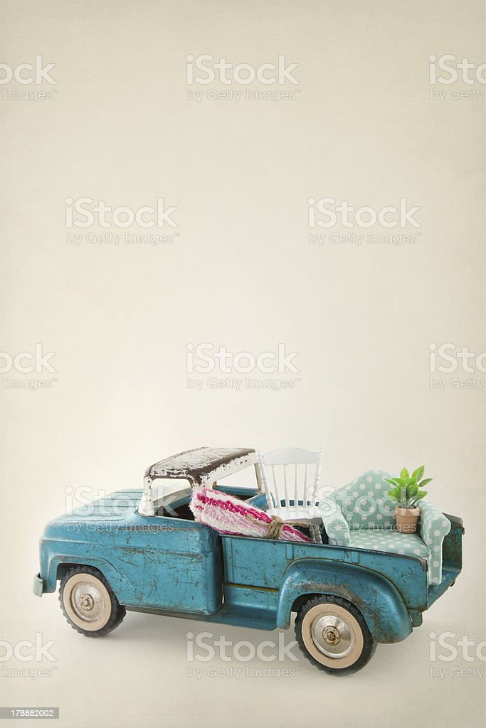 Toy truck packed with colorful furniture royalty-free stock photo