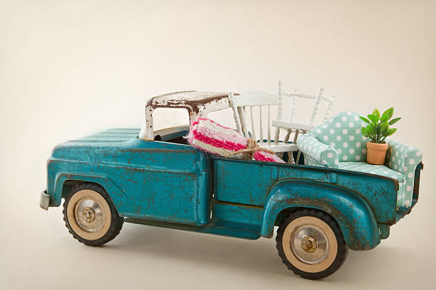 Toy truck packed with furniture stock photo