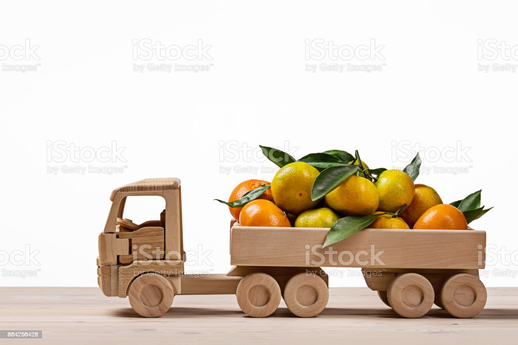 Toy truck with tangerines and clementines. royalty-free stock photo