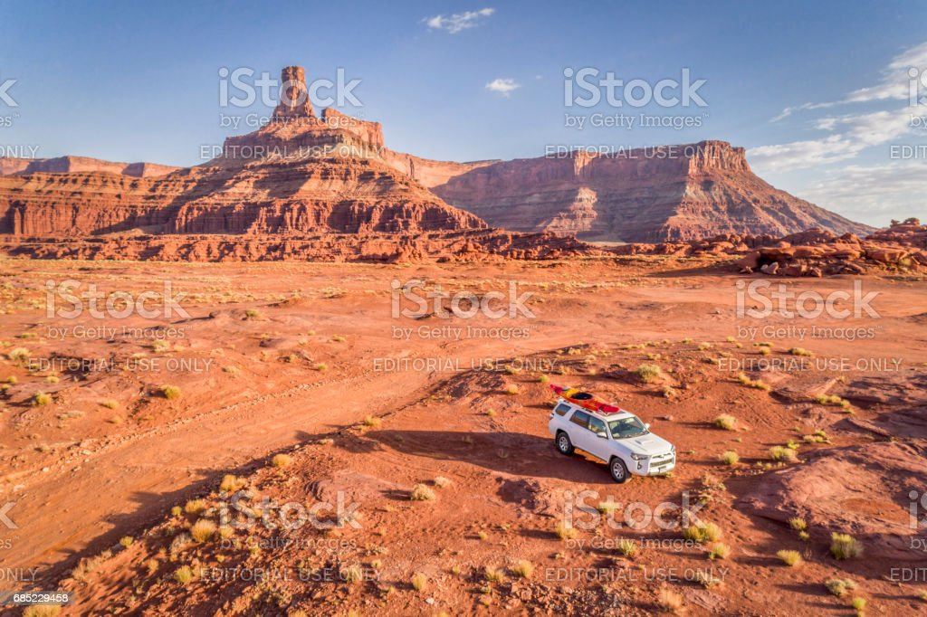 Toyota 4runner SUV with a kayak on roof on a desert trail stock photo