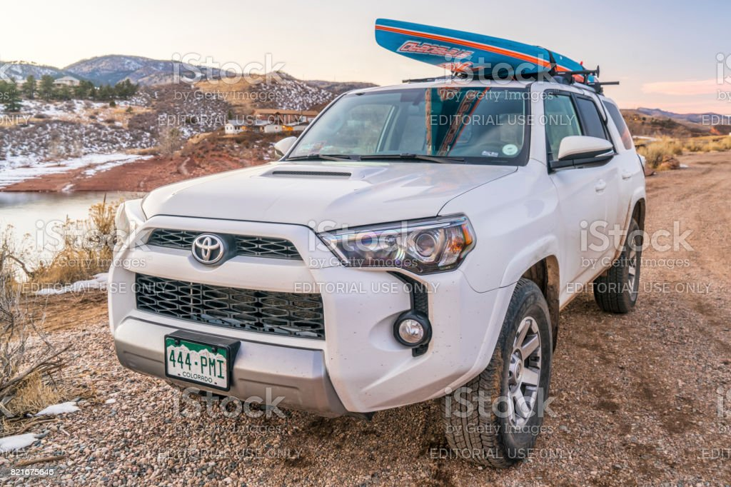 Toyota 4Runner SUV with paddleboard stock photo