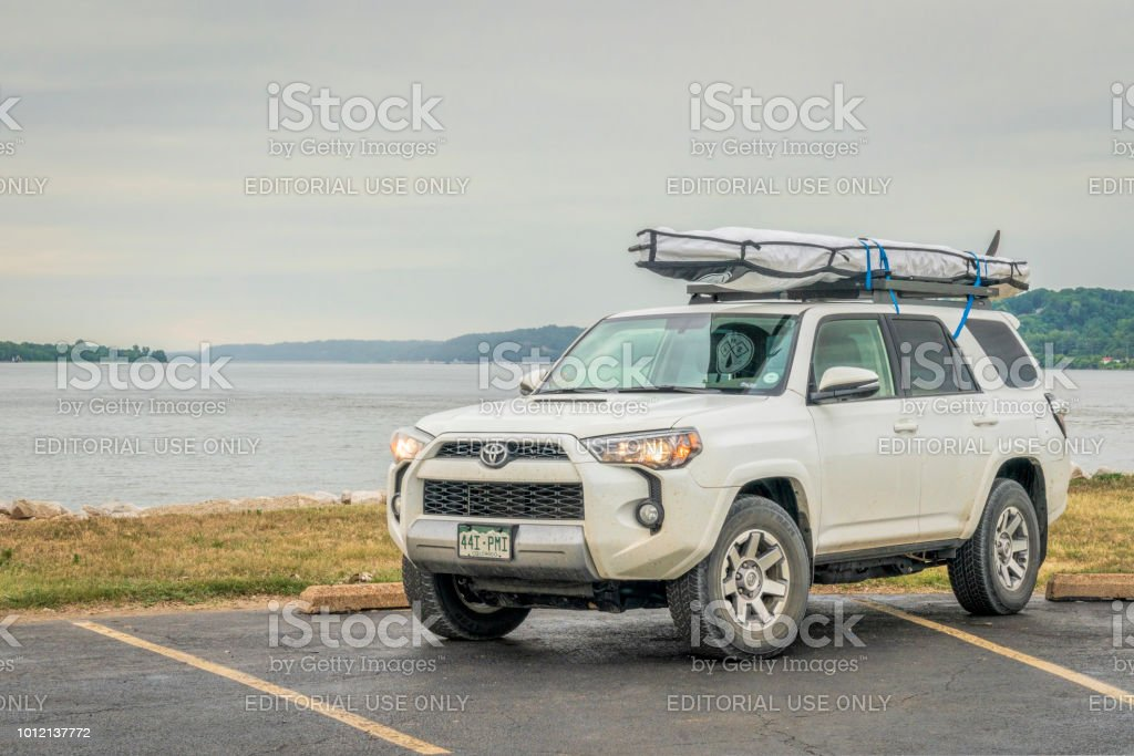Toyota 4Runner SUV with stand up paddleboard stock photo