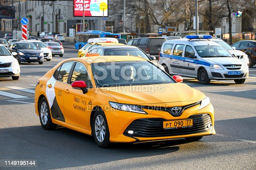 Moscow, Russia - April 19, 2019: Taxi car Toyota Camry in the city street.