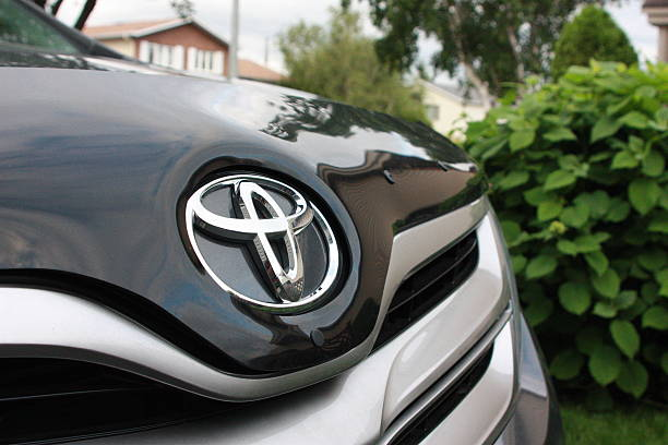 Toyota Car Logo Longueuil, Canada - June 17, 2013: Toyota logo on the hood of a parked Toyota Venza vehicle brand name stock pictures, royalty-free photos & images