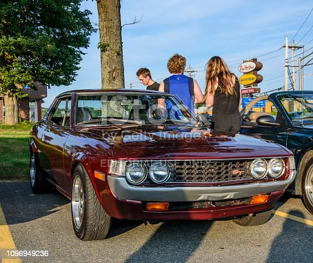 Dartmouth, Nova Scotia, Canada - August 3, 2017: 1976 Toyota Celica ST at the weekly summer A&W Cruise-in, Woodside Ferry Terminal parking lot Dartmouth, Nova Scotia. People wander among the parked classic cars on a very pleasant summer evening.