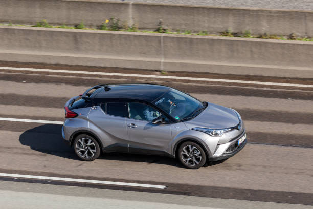 Toyota C-HR hybrid on the highway Frankfurt, Germany - Sep 19, 2017: Toyota C-HR hybrid subcompact crossover suv driving on the highway in Germany hybrid car stock pictures, royalty-free photos & images