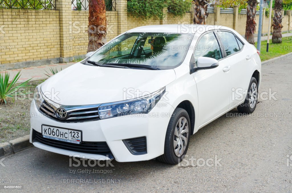 Sochi, Russia - October 11, 2016: Toyota Corolla parked on the street of Sochi City, suburb. Introduced in 1966, the Corolla was the best-selling car worldwide by 1974 and has been one of the best-selling cars in the world since then. stock photo