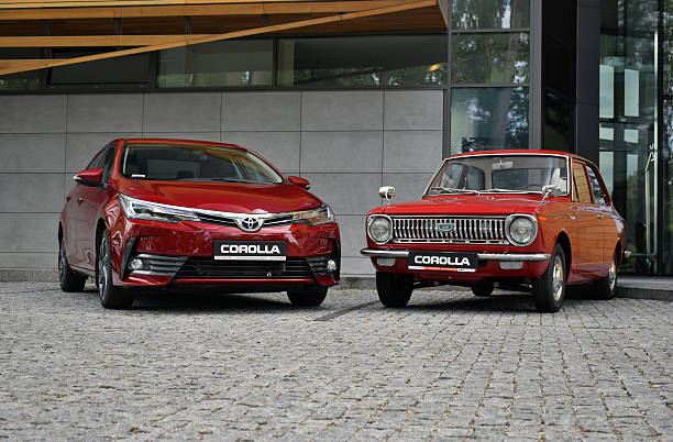 toyota corolla - the newest and the oldest generation - historic vs new stock photos and pictures