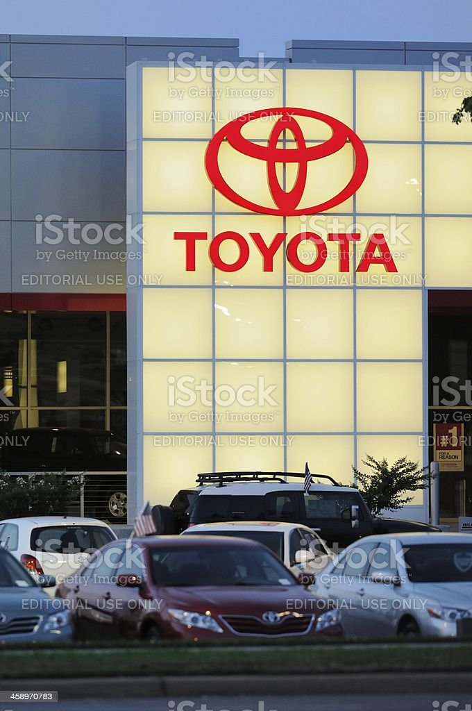 Toyota dealership with sign at sunset stock photo