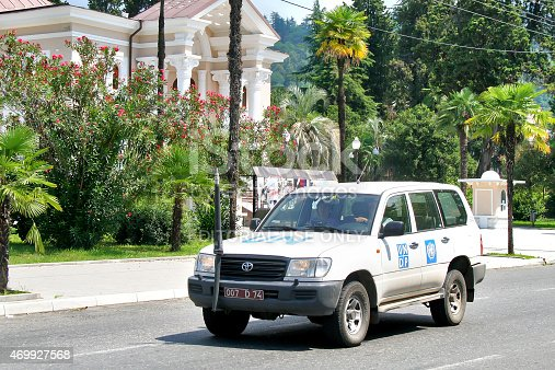 Sukhumi, Abhazia - July 23, 2009: White Toyota Land Cruiser 100 of the UN mission in Abkhazia and Georgia drives at the city street.
