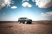 Merzouga, Morocco - September 25, 2019: Offroad car Toyota Land Cruiser Prado 150 in the Sahara desert.
