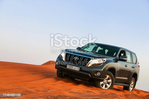 Merzouga, Morocco - September 24, 2019: Offroad car Toyota Land Cruiser Prado 150 in the dunes of the Sahara desert.