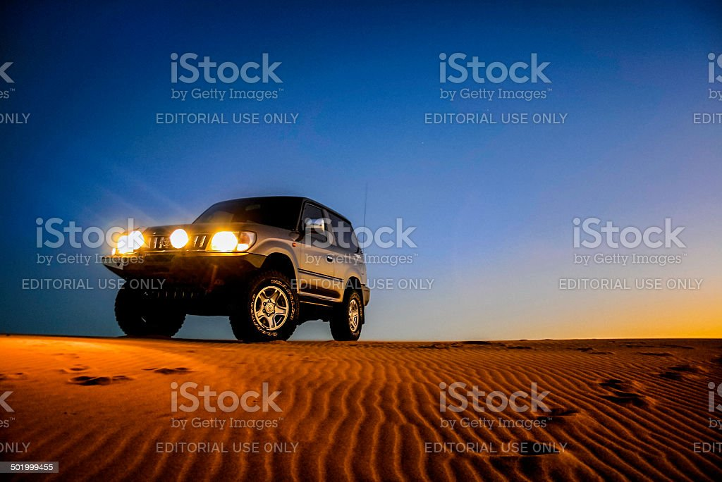 Toyota Land Cruiser Prado on desert sand dunes stock photo