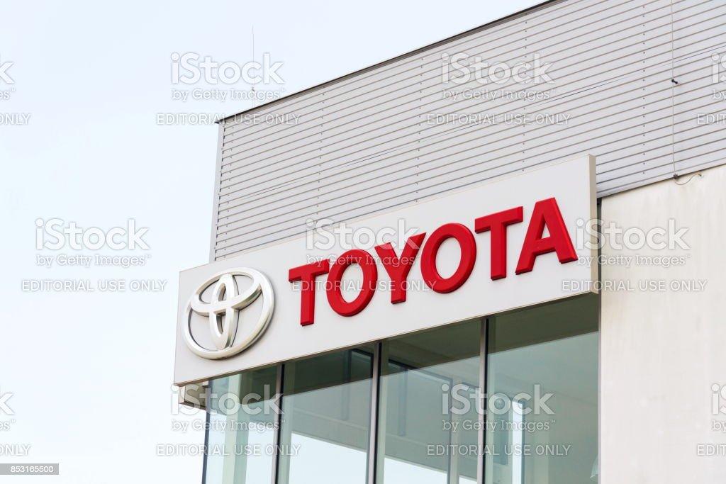 Toyota motor corporation logo on dealership building stock photo