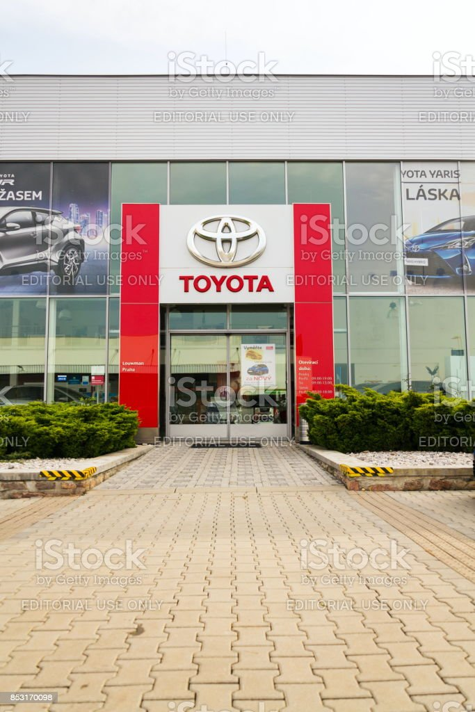 Toyota motor corporation logo on dealership building stock photo