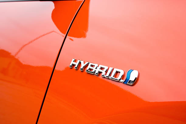 Toyota Prius Hybrid logo Hong Kong, China - February 29, 2012: The hybrid logo found on the side of the new Toyota Prius hybrid vehicle. hybrid vehicle stock pictures, royalty-free photos & images