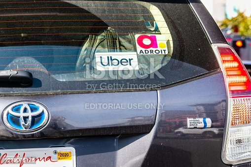 586078104 istock photo Toyota Prius Hybrid vehicle used for rides for UBER and Adroit 1218076178