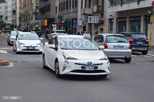 Milan, Italy - 28th May, 2018: Toyota Prius vehicles in taxi version driving on a street. This model is very popular taxi vehicle in Europe.