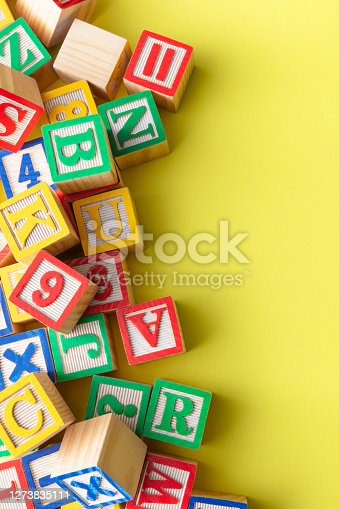 Alphabet Blocks on Yellow Background Still Life with Copy Space. More toys, school and baby goods photos can be found in my portfolio. Please have a look